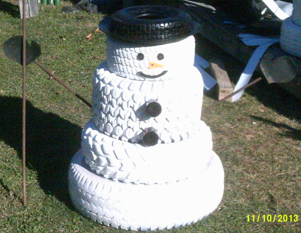 Tire stores get creative for the holidays your next tire for Snowmen made from tires